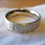 mokume gane wedding ring with rails